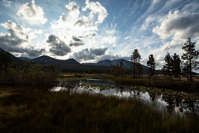 A pond reflects the sky and the sun slowly setting near Lake Tahoe, south of Tahoma, California, USA, 09 September 2019 (Issued 14 September 2019). Located in the Sierra Nevada Mountains at the junction of the states of California and Nevada, Lake Tahoe is the biggest mountain lake in North America, covering 502 square kilometers, its elevation is 1987 meters above sea level and its depth is 501 meters. The area is very touristic offering activities thourghout the year from winter sports in the surrounding mountains to water activities. However, according to recent reports, Scientists have detected microplastic pollution in Lake Tahoe's deep blue waters for the first time and are looking for the source and potential harm for the local fauna and flora. Moreover, a certain type of invasive shrimp introduced in the 60s to fatten trout have seen its population grow exponentially to a point that they now pose a major threat to the lake's clarity.