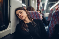 exhausted woman sleeping on train