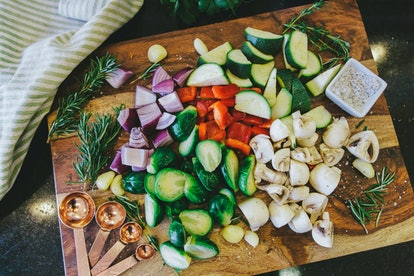 Chopped vegetable medley on wooden cutting board