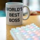 world's best boss mug near to colourful rgb keyboard