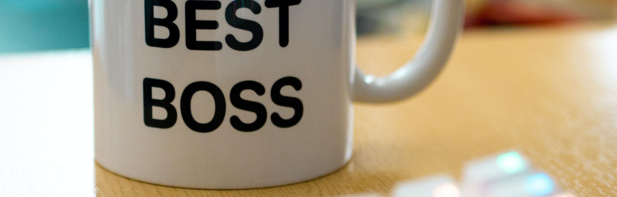 world's best boss mug near to colourful rgb keyboard