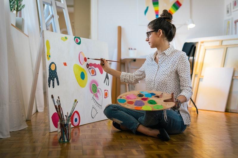 Getting creative.woman painting in her art studio