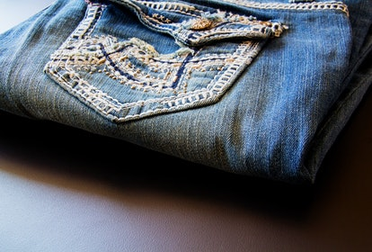 Jeans with embellished back pockets are an early 2000s fashion trend.