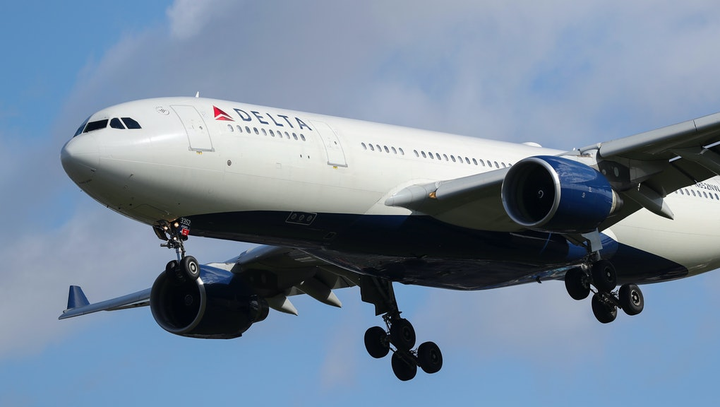 A Delta Air Lines N852NW (Airbus A330 - MSN 614) plane as it lands at London Heathrow airport in blu...