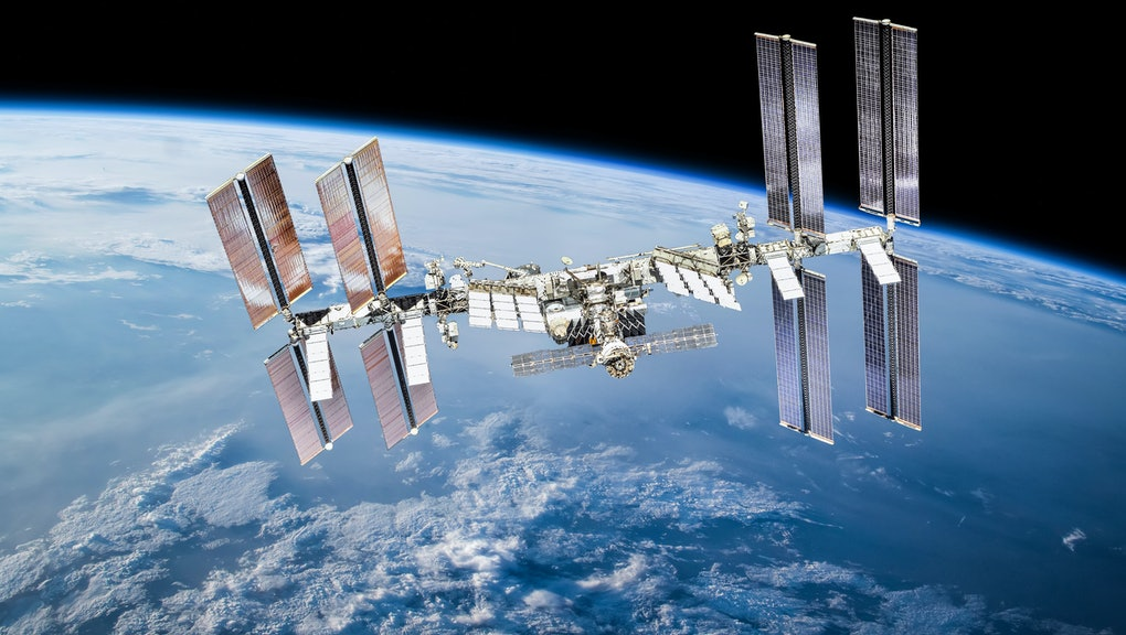 International space station on orbit of Earth planet. ISS. Dark background. Elements of this image furnished by NASA
