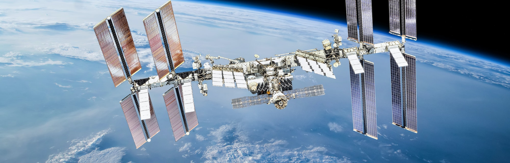 International space station on orbit of Earth planet. ISS. Dark background. Elements of this image f...