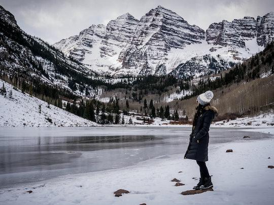 Hiking Maroon Bells outside of Aspen Colorado.  Women takes in the beautiful scenery.