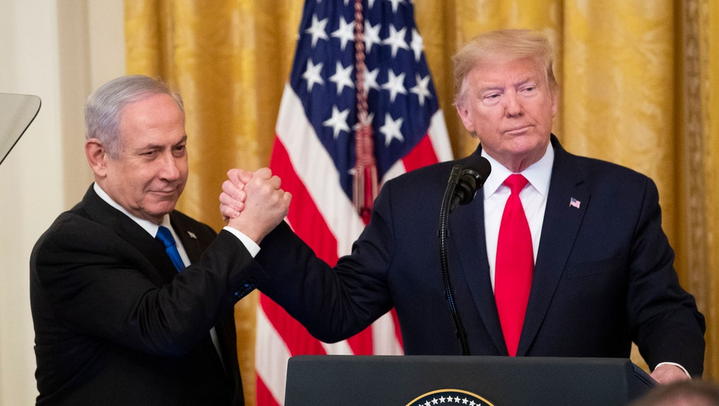 US President Donald J. Trump (R) shakes hands with Prime Minister of Israel Benjamin Netanyahu while...