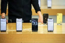 A customer looks on an iPhones 11 Pro Max at the Apple Store during the start of sales of the iPhone...