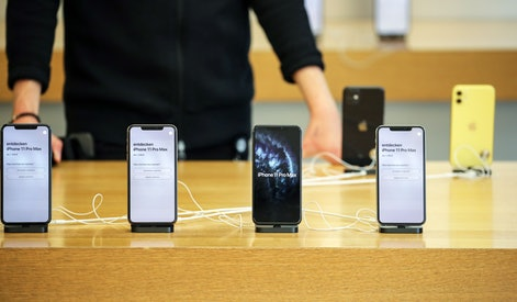 A customer looks on an iPhones 11 Pro Max at the Apple Store during the start of sales of the iPhone 11, iPhone 11 Pro, and Apple Watch Series 5 at the Apple Store in Frankfurt Main, Germany, 20 September 2019.