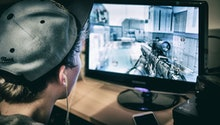 Teenager Playing Call of Duty Video Game on Xbox One