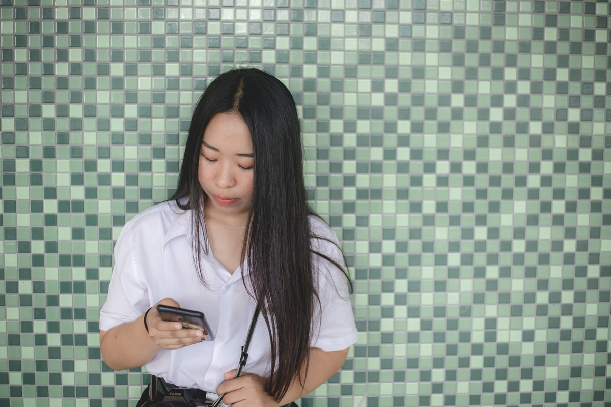 Young women use mobile phones