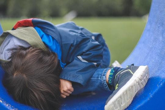 Little sad boy at public park