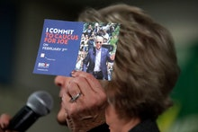 Former First Lady of Iowa Christie Vilsack holds up a card encouraging people to caucus for Democrat...