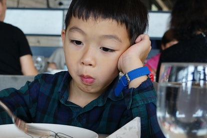 An Asian picky eater boy with boring expression.