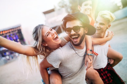 Group of friends having fun time at music festival