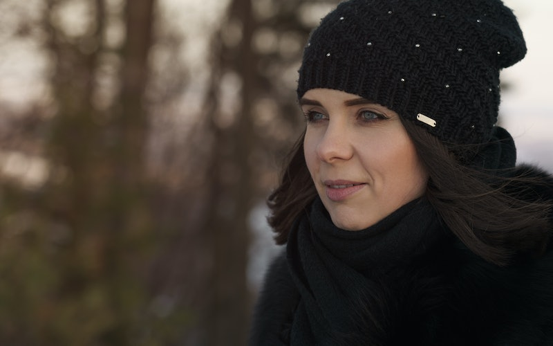 Portrait of woman in hat and winter wear outdoor