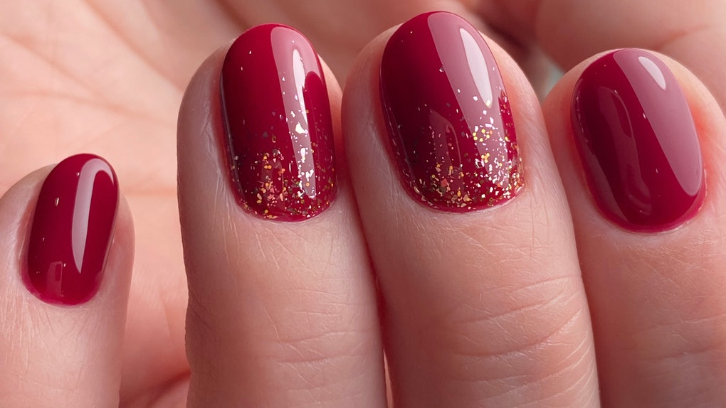 Red gold design nail art in beauty salon