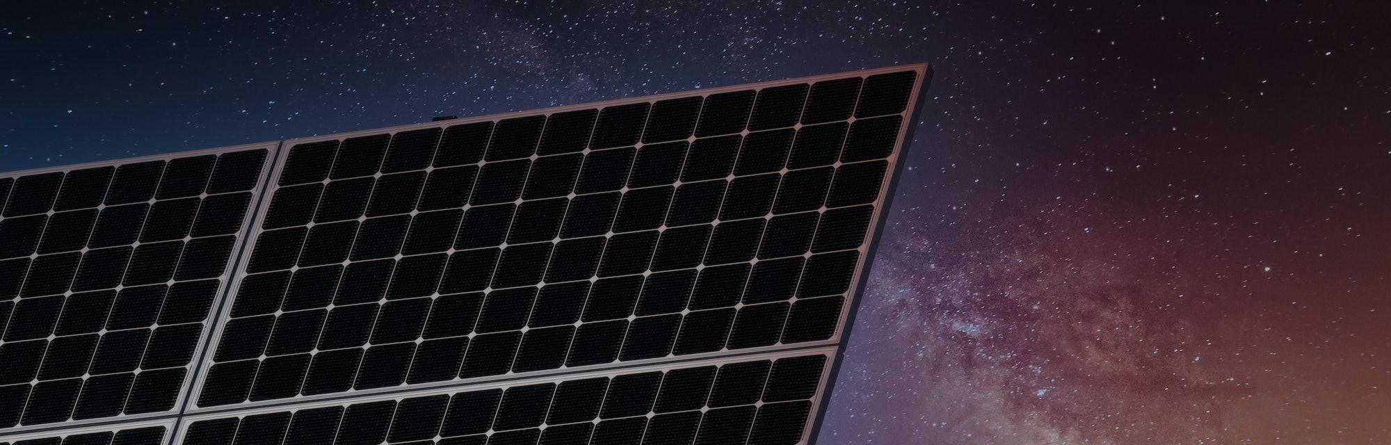 A solar panel seen against the night sky