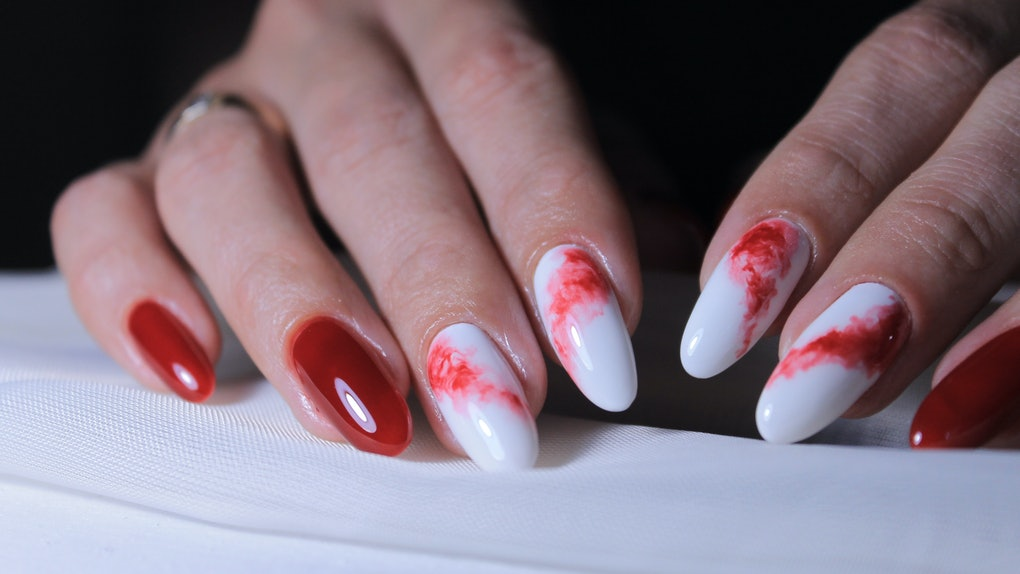 red manicure design with the image of spilled paint on a light background