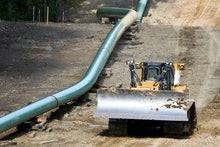 Segments of assembled pipe are lined up along a cleared section of woods where a pipeline for shale ...