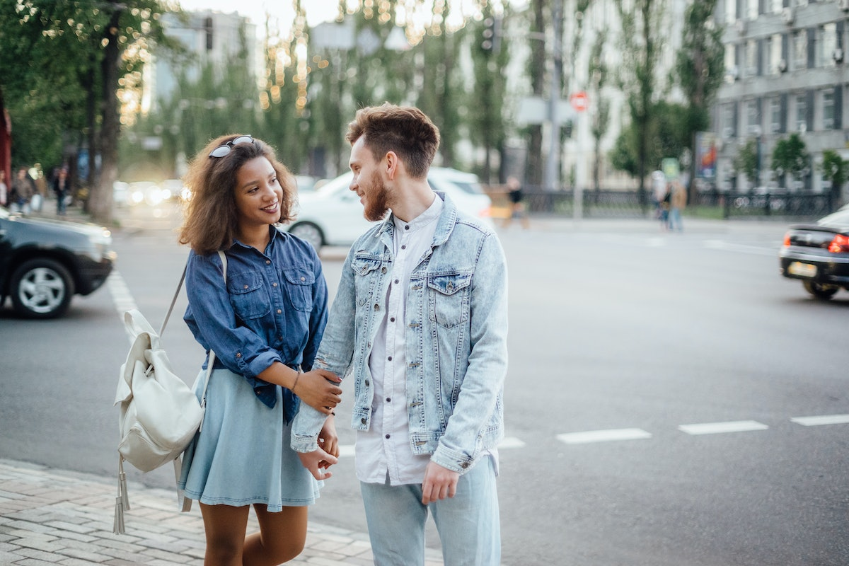 Young couple in love embrace in the street of the european city.
