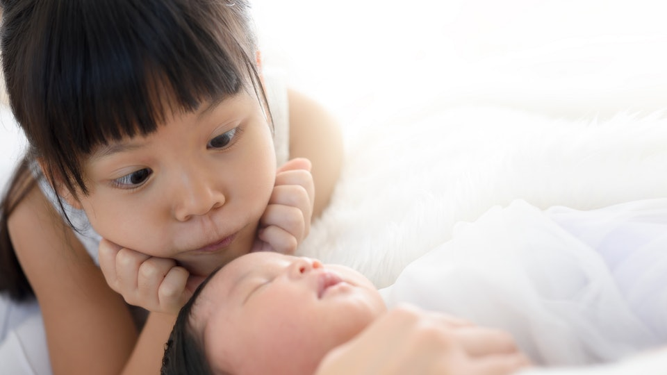 Pediatricians don't recommend keeping babies totally away from sick siblings, but do suggest some space.
