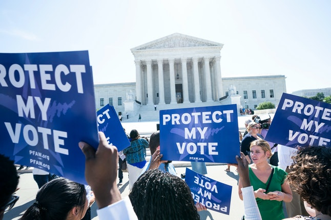 Immigration activists gather outside the US Supreme Court to await the justices' ruling on the Trump administration's attempt to add a citizenship question to the US census in Washington, DC, USA, 27 June 2019. The high court also ruled on partisan gerrymandering cases in Maryland and North Carolina.