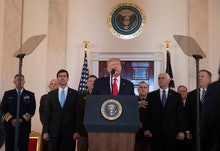 US President Donald J. Trump (C) delivering a statement on the US response to Iranian missile strike...