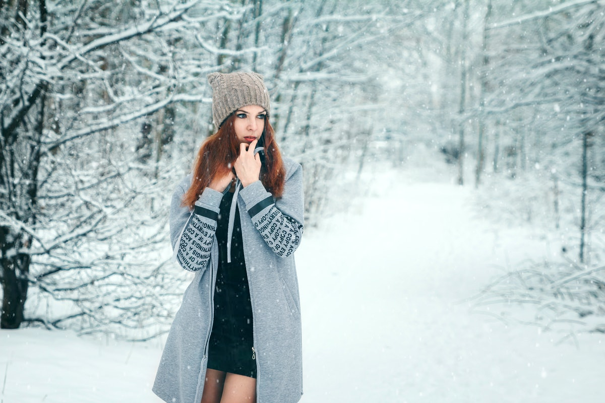 Winter, a girl in a winter forest, snow. Concept of the New Year holidays, rest.