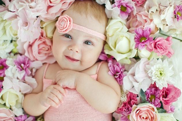 Little baby lying in flowers