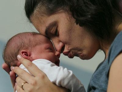 Mother nuzzling her newborn