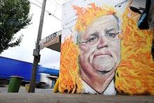 A mural depicting Australian Prime Minister Scott Morrison among bushfire flames is seen in Tottenha...