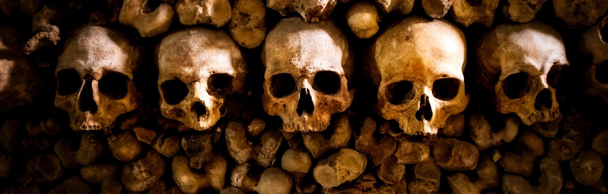 skulls and bones in Paris Catacombs France