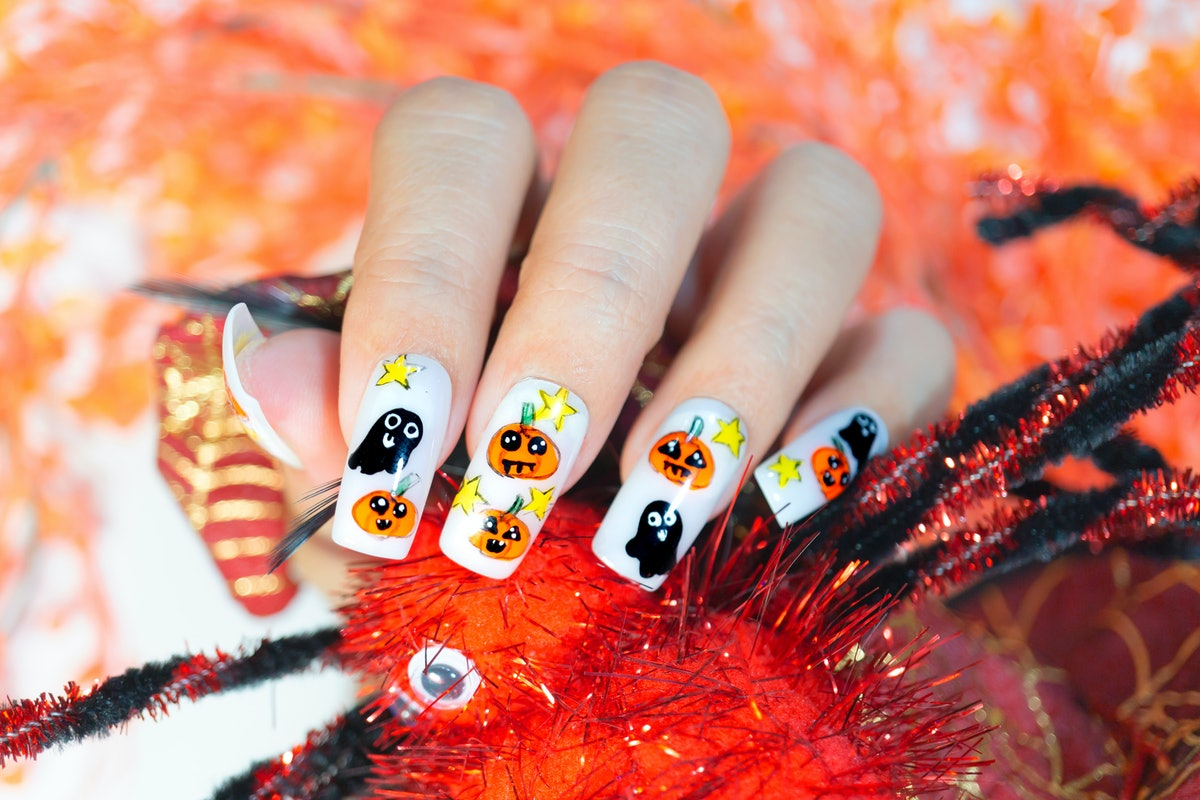 cute lovely orange pumpkin and little black ghost painting on fashionista woman acrylic fingernail,g...