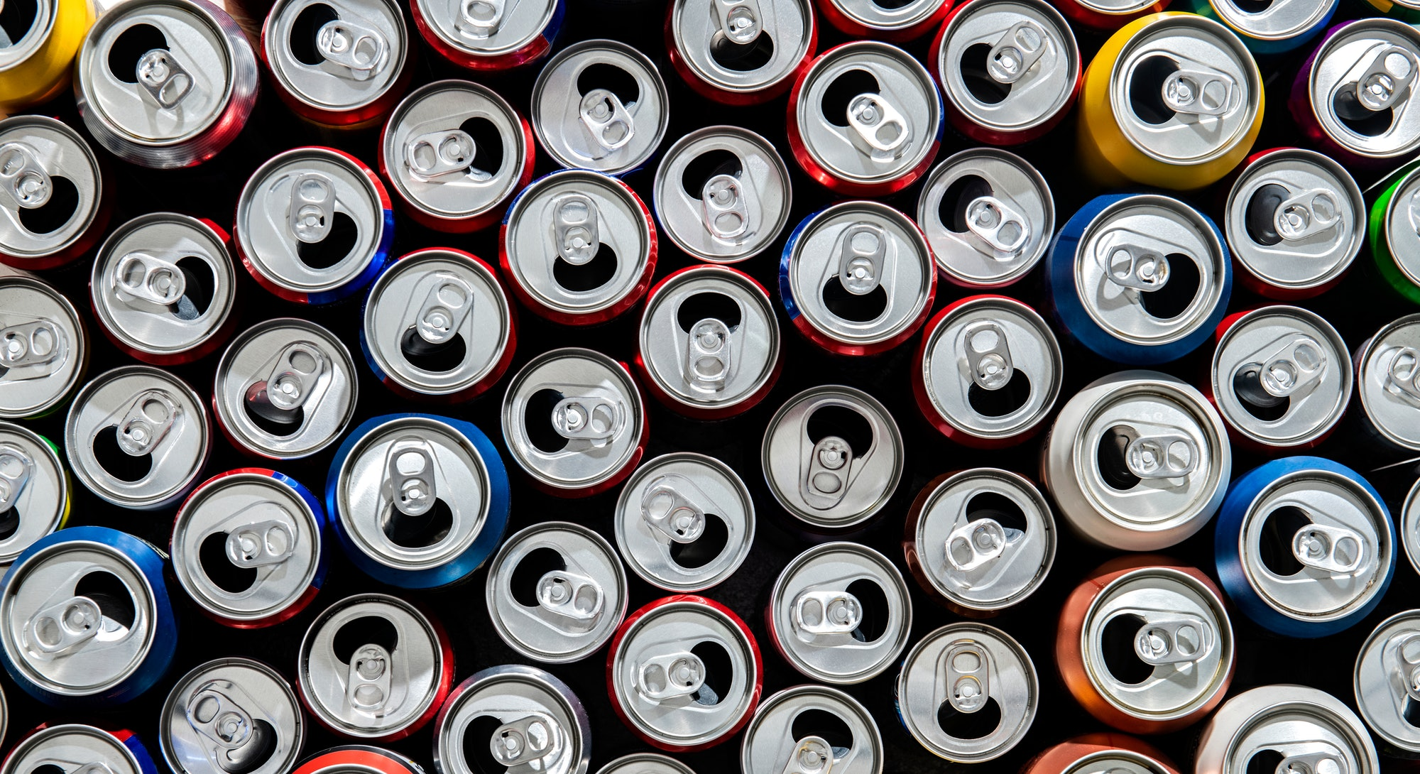 Recycling aluminum or metal empty cans top view. Group of cans for reuse and recycle. - Image