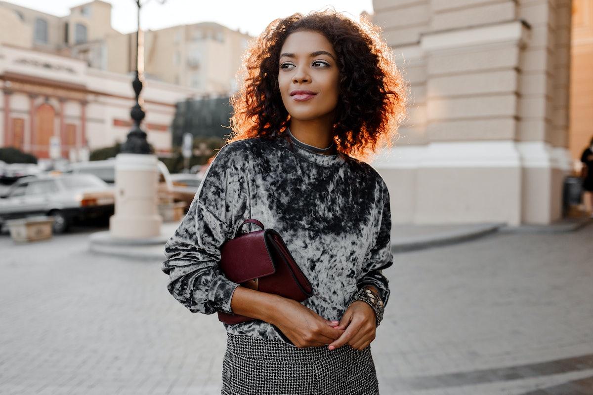 Fashionable black girl in  amazing grey velvet sweater , luxury jewelry  accessories   walking  in P...