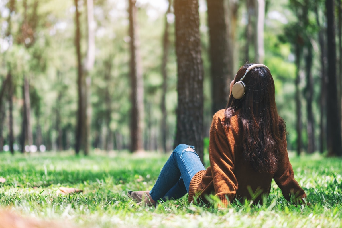 A beautiful asian woman enjoy listening to music with headphone with feeling happy and relaxed in th...