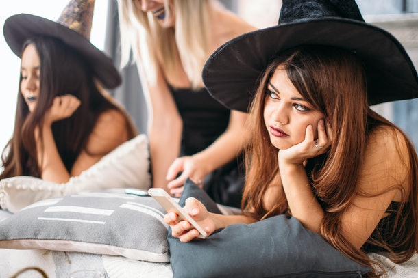 witches use the phone and tire at the Halloween party