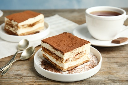Composition with tiramisu cakes and tea on table
