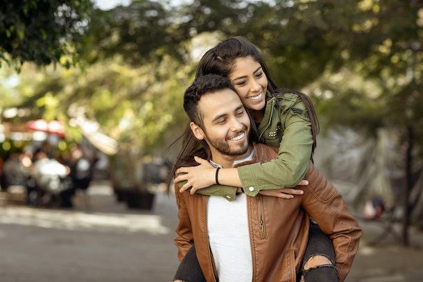 Couple in love. Enjoying happy in public park