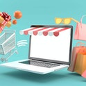 The shopping cart floating out of the online store on a blue background.-3d rendering.