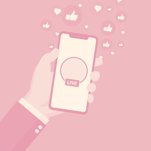 Social Media Marketing Solution - isolated on blue background. For web site,campaign,ui,ad and app. Hand holding phone with live icon and hearts and thumbs.