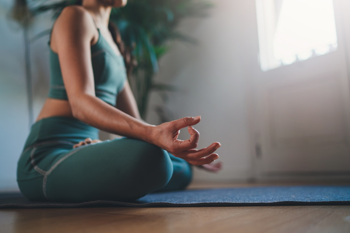 Morning Mindfulness Meditation, Closeup of young woman practicing yoga in the morning sitting straig...