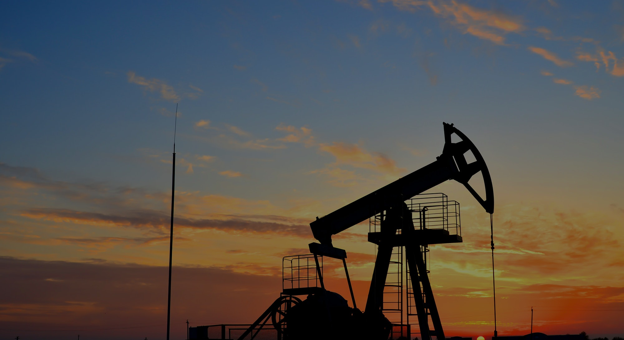 Oil drilling derricks at desert oilfield for fossil fuels output and crude oil production from the g...