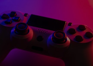 Game controller with blue and red lights - Selective Focus