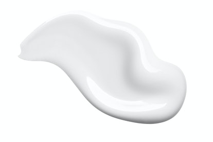 White cosmetic face cream texture. Lotion smear isolated on white background. Beauty skincare produc...