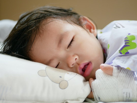 Sick Asian baby girl, 15 months old, falling asleep and breathing through her mouth as she has a nasal congestion, could not breath through her nose