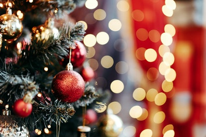 Close up of balls on christmas tree. Bokeh garlands in the background. New Year concept.