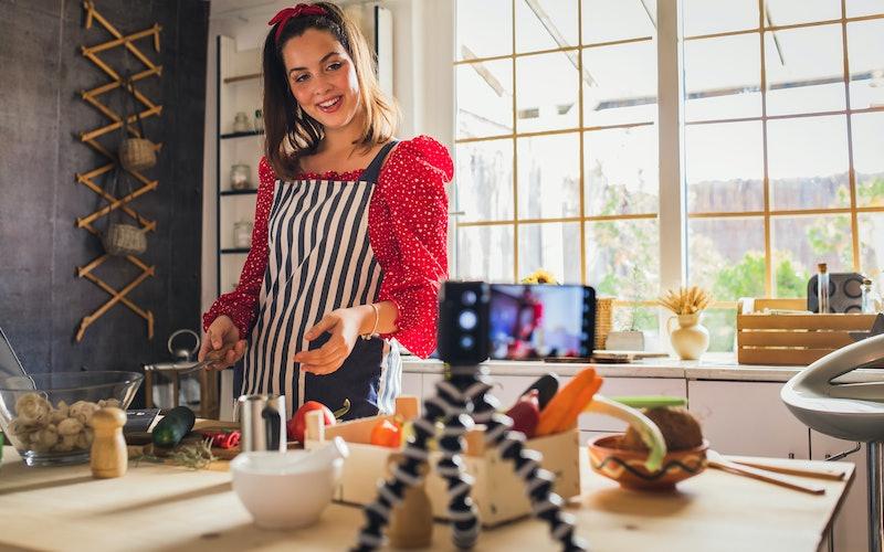 Woman blogging in her kitchen.